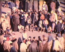 8MM MOROCCO - Marrakech - show on place Jemaa el-Fnaa - 1963 Stock Footage