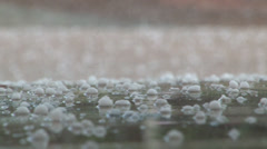 Ground level view of hail falling. - stock footage