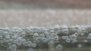 Stock Video Footage of Ground level view of hail falling.