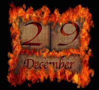 burning wooden calendar december 29. - stock illustration