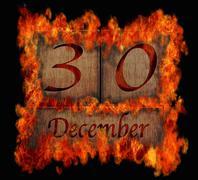 burning wooden calendar december 30. - stock illustration
