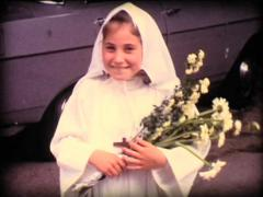 8MM timid teen at catholic communion - 1967 Stock Footage