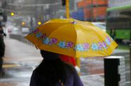 Stock Photo of Yellow umbrella in the rain