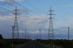 Stock Photo of Electricity pylons besides road