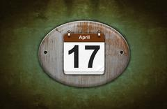 Old wooden calendar with april 17. Stock Illustration