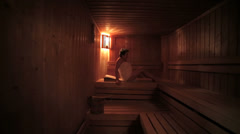 Senior woman relax in sauna - stock footage