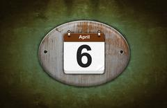 Old wooden calendar with april 6. Stock Illustration