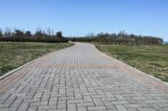 Stock Photo of the road made by the bricks at the grassland