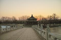 sunrise at the seventeen hole bridge in summer palace - stock photo