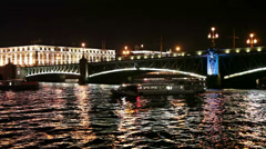 View from Neva river on Trinity bascule bridge at night Stock Footage
