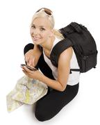 blond tourist with gps - stock photo