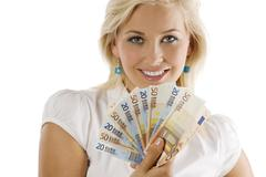 smilig girl with cash - stock photo