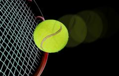 tennis ball and raquet over black - stock illustration
