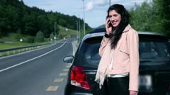 Pretty woman in distress with broken car seductive look at help Stock Footage