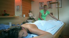 Female therapist folding the towel after massage Stock Footage