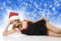 sexy girl with christmas hat laying - stock photo