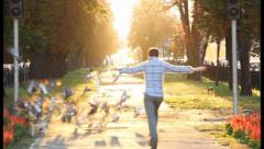 Time of life jumping man enjoys lifetime, flying birds happiness, click for HD Stock Footage
