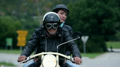 Middle aged couple on retro motorcycle - stock footage