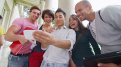 Happy group of student friends pose to take their picture with a smartphone Stock Footage