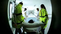 CG digital graphic of multi ethnic accident emergency staff rushing patient - stock footage