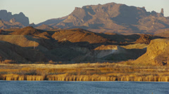 Mountains behind the Colorado River Stock Footage