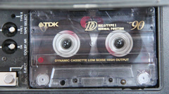 Cassette recorder fast forwarding a tape Stock Footage