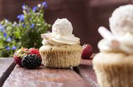 Stock Photo of cupcake with strawberries and flowers