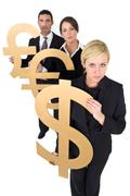 Stock Photo of three business people man and women currency concerns