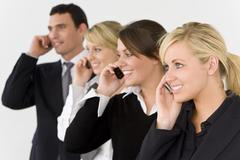 Business communications team man and three women Stock Photos
