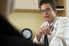 male doctor and patient consultation - stock photo