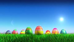 Stock Video Footage of Easter Eggs on grass field with copy-space above