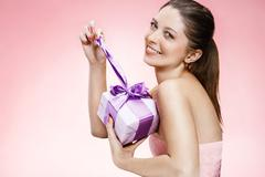 Young beautiful girl with a gift box ribbon - stock photo