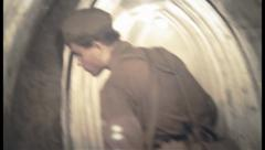 Underground pillbox atmosphere, soldiers in the shelter tunnel, click for HD Stock Footage
