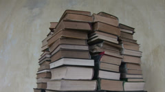 Pans the pile of old books 1 Stock Footage
