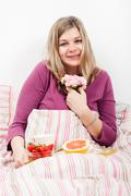 Pleased woman with romantic breakfast Stock Photos