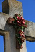 Crucifix with ceramic flowers Stock Photos