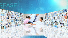 3D video wall Indian Caucasian African American medical team caring patients Stock Footage
