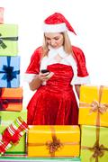 christmas woman texting message - stock photo