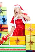 Stock Photo of christmas woman pointing at presents