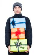 Stock Photo of shocked winter man with presents