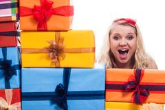 shocked woman with presents - stock photo