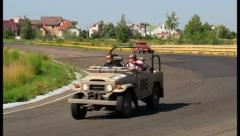 Toyota Landcruiser FJ40, Volkswagen Beetle in retro cars rally, click for HD Stock Footage