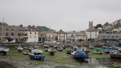 Brixham harbour Devon England at low tide - stock footage