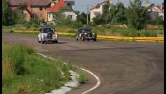 Citroen 11B overtakes Bentley R Type. Retro cars tough racing., click for HD Stock Footage