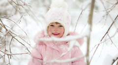 woman and child playing with snow in winter - stock footage