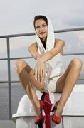 stylish woman on deck - stock photo