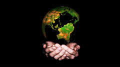Earth globe, rotating over an hands - earth in palms Stock Footage