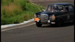 Stock Video Footage of Black classic Mercedes Benz 300 SE turning on the road, click for HD