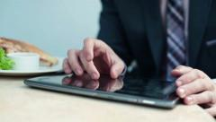 Businessman working on tablet computer during lunch HD Stock Footage