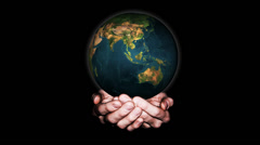 Earth globe, rotating over an hands - earth in palms - stock footage